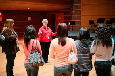 A docent gives a tour of our theater